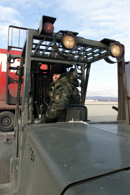 STAFF Sergeant (SSGT) Jarrod Williams from the 100th Maintenance Squadron (MS), prepares to off-load maintenance equipment arriving at Borgas International Airport, Bulgaria, in support of Operation ENDURING FREEDOM
