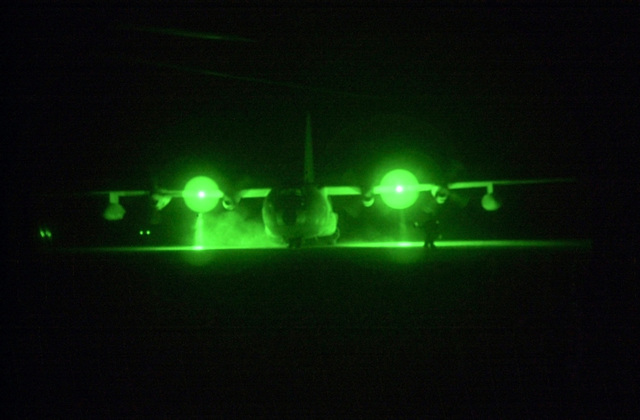 """A KC-130 from VMGR-252, Marine Corps Air Station (MCAS) Miramar, California, lands at """"Camp Rhino"""" to offload personnel and cargo in support of Operation ENDURING FREEDOM"""