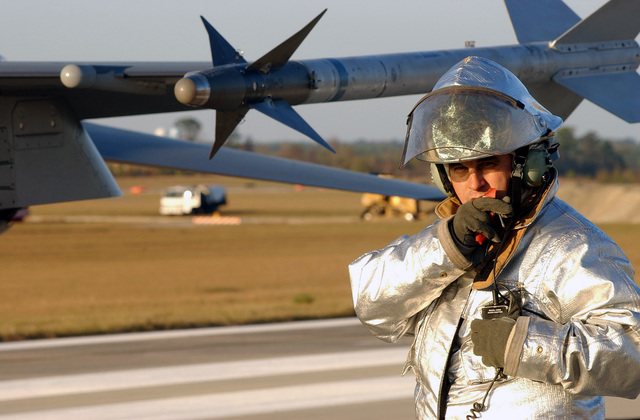 US Air Force (USAF) STAFF Sergeant (SSGT) Ernest Jillson, 20th Civil Engineering Squadron, Fire Department, prepares to inspect a US Air Force (USAF) 55th Fighter Squadron F-16CJ, Fighting Falcon aircraft, following a barrier certification test at Shaw AFB, South Carolina (SC), during Operational Readiness Exercise Sea Lion 02-02