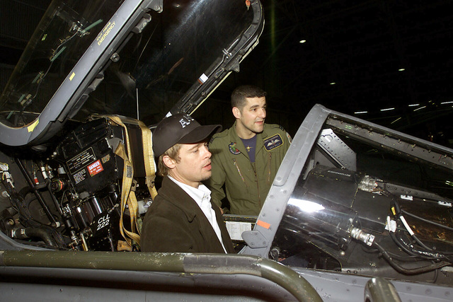 """Actor Brad Pitt site in the cockpit of a Royal Air Force (RAF) GR3A Jaguar aircraft as RAF Flight Lieutenant, Rich Wells looks on, at Incirlik AB, Turkey. Brad Pitt and member of the Warner Brother's movie """"Ocean's 11"""" crew visited with deployed military personnel during Operation NOTHERN WATCH"""
