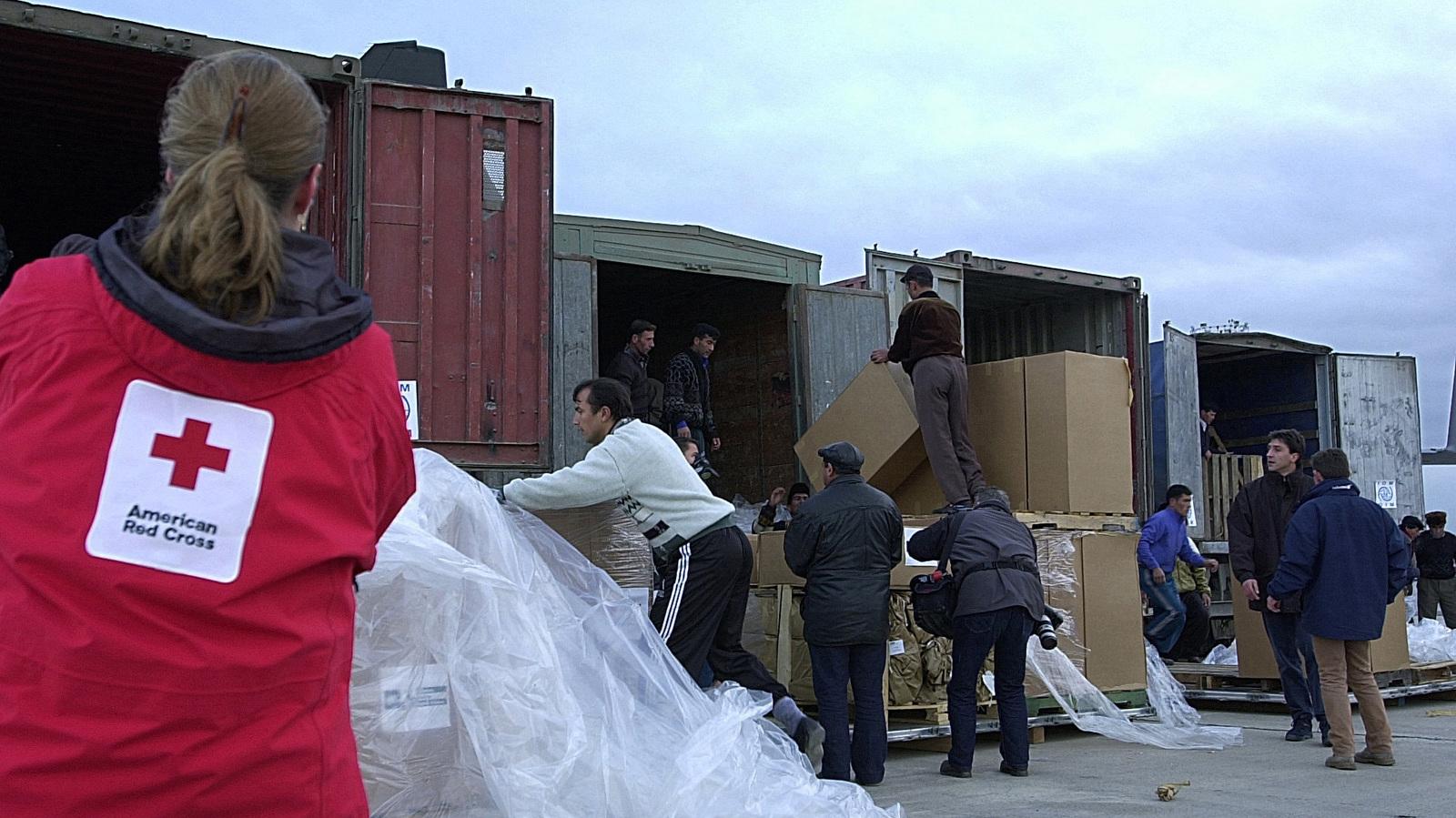 "Turkmenistan workers load pallets of ""America's Fund for Afghan Children"" humanitarian aid onto trucks at Ashgabat, Turkmenistan"