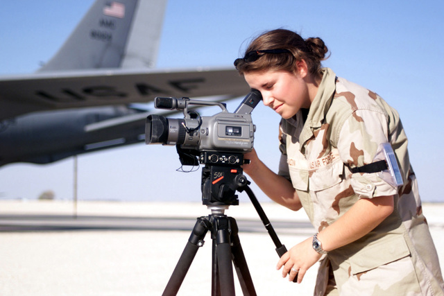 Motion Video SPECIALIST, AIRMAN Michelle Gaudin, captures the action of a busy flight line at an air base in Southwest Asia, during Operation ENDURING FREEDOM
