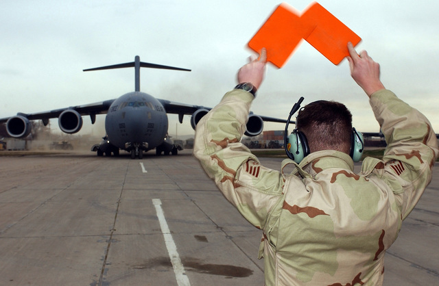The Honorable Donald H. Rumsfeld, U.S. Secretary of Defense arrives at Camp Stronghold Freedom, Uzbekistan via C-17 Globemaster aircraft while visiting troops during Operation Enduring Freedom. (U.S. Air Force photo by STAFF SGT. Steven Pearsall) (Released)