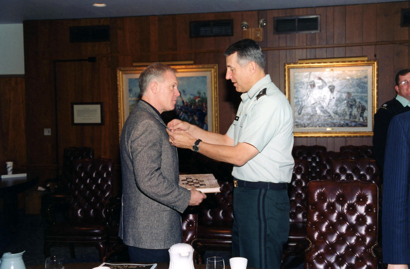 Pennsylvania State Representative the Honorable H. William DeWeese, receives a Centennial Pin from United States Army War College Commandant, Major General (MGEN) Robert Ivany during a recent visit