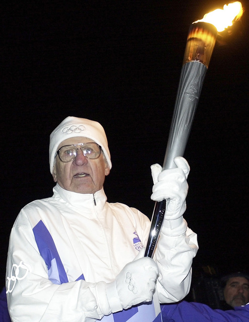 World War Two (WWII) Veteran, US Air Force (USAF) Colonel (COL) (Retired) Frank E. Herrelko Sr., carries the Olympic flame during his leg of the 2002 Olympic Torch Relay in Washington, D.C