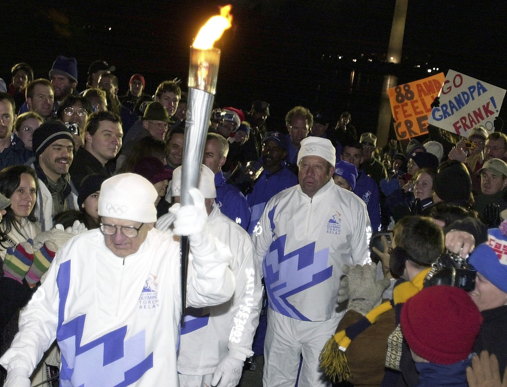 World War Two (WWII) Veteran, US Air Force (USAF) Colonel (COL) (Retired) Frank E. Herrelko Sr. (front), Vietnam Veteran Mr. Earl Gillespie (center) and Korean War Veteran Mr. Glbert Lyons participate in the 2002 Olympic Torch Relay in Washington, D.C