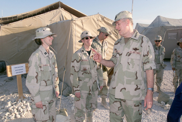 Captain (CAPT) Kimberly Daniels gets advice from the Chairman of the Joint Chiefs of STAFF (CJCS), United States Air Force (USAF) General (GEN) Richard B. Myers, during his area visit in support of Operation ENDURING FREEDOM