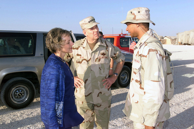 Captain (CAPT) Michael Myers speaks with the Chairman of the Joint Chiefs of STAFF (CJCS), United States Air Force (USAF) General (GEN) Richard B. Myers and the Generals wife Mary Jo, during their area visit in support of Operation ENDURING FREEDOM