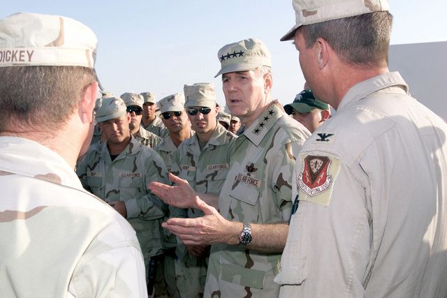 Chairman of the Joint Chiefs of STAFF (CJCS), United States Air Force (USAF) General (GEN) Richard B. Myers speaks to Air Force men and women at an air base, during his area visit in support of Operation ENDURING FREEDOM