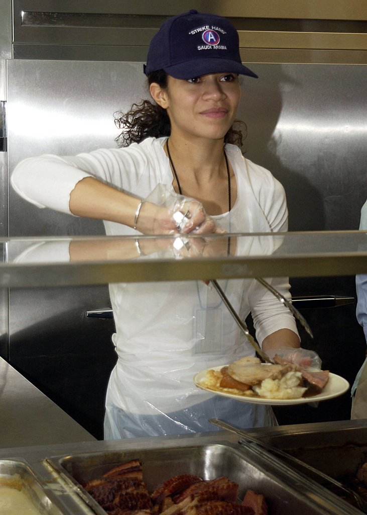 "Actress Sherri Saum, from the television daytime series ""One Life to Live"" helps to serve Christmas dinner to US Air Force (USAF) personnel stationed at Prince Sultan AB, Saudi Arabia as part of the United Service Organizations (USO) Operation Starflight Freedom Tour"