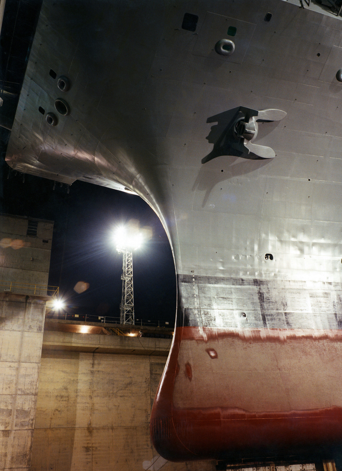 A view of the bulbous bow of the Nimitz Class Aircraft Carrier, USS NIMITZ (CVN 68), while the ship sits in the graving dock area of the dry dock facilities at the Puget Sound Navy Yard in Bremerton, Washington (WA)