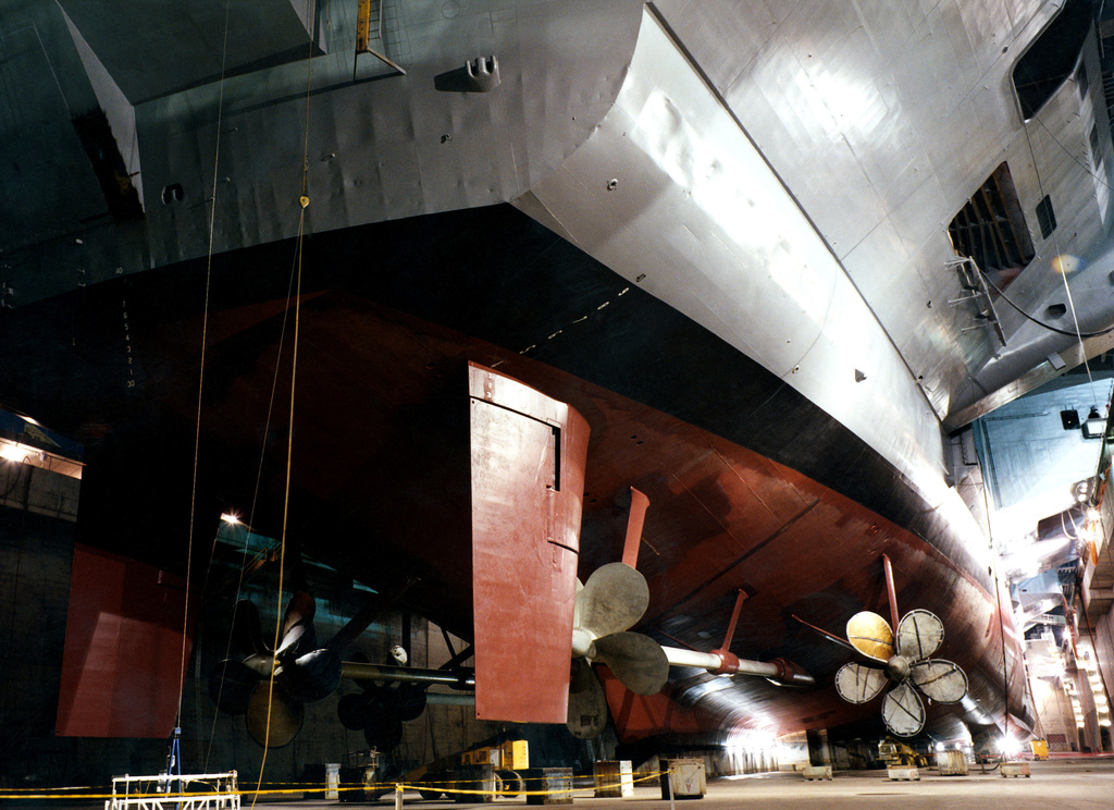 A view of the rudder, struts, and propellers located at the stern of the Nimitz Class Aircraft Carrier, USS NIMITZ (CVN 68), while the ship sits in the graving dock area of the dry dock facilities at the Puget Sound Navy Yard in Bremerton, Washington (WA)