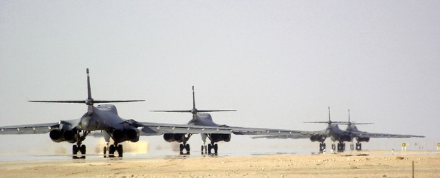 Four US Air Force B-1B Lancers, 405th Air Expeditionary Wing (AEW), taxi down the runway prior to taking off on a combat mission during Operation ENDURING FREEDOM
