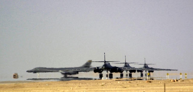 The first of four Air Force B-1B Lancers, 405th Air Expeditionary Wing (AEW), turn onto the runway and prepares to take off on a combat mission followed by his three wingmen, during Operation ENDURING FREEDOM