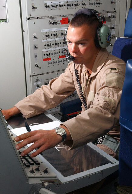 An E-3C Sentry Electronic Combat Officer, 963rd Airborne Air Control Squadron (AACS), Tinker AFB, Oklahoma, assigned to the 405th Air Expeditionary Wing (AEW), coordinates the electronic air war during a 14.5-hour mission controlling the air space over Afghanistan during Operation ENDURING FREEDOM