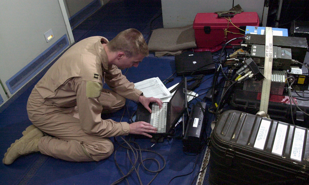 An E-3C Sentry Navigator, 963rd Airborne Air Control Squadron (AACS), Tinker AFB, Oklahoma, assigned to the 405th Air Expeditionary Wing (AEW), uses the Data Set satellite communication system to send weather information back to deployed weather personnel. He sent the information while on a 14.5-hour mission controlling the air space over Afghanistan during Operation ENDURING FREEDOM