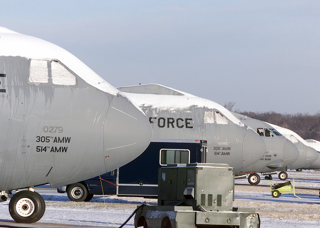 A row of C-141B Starlifters, 305th Air Mobility Wing (AMW), await deicing on the flightline at McGuire AFB, New Jersey, after the first snow of the winter season
