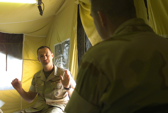 Lieutenant Colonel Nathan Lowrey (right), Marine Corps Historian, conducts a oral history interview with Major Mahaney, USMC, N-3/N-5 Plans and Operations Officer for Combined Task Force 58, at Naval Support Activity, Bahrain on 11 Jan 2002, during OPERATION ENDURING FREEDOM