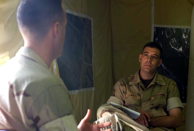 Lieutenant Colonel Nathan Lowrey, right, Marine Corps Historian, conducts a oral history interview with Major Mahaney, USMC, N-3/N-5 Plans and Operations Officer for Combined Task Force 58, at Naval Support Activity, Bahrain, during OPERATION ENDURING FREEDOM