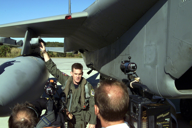 Major (MAJ) John Black, USAF, Pilot, 125th Fighter Wing (FW), Jacksonville International Airport (IAP), explains some of the functions of an F-15C Eagle to members of several Central Florida news teams at Cape Canaveral Air Station, Florida