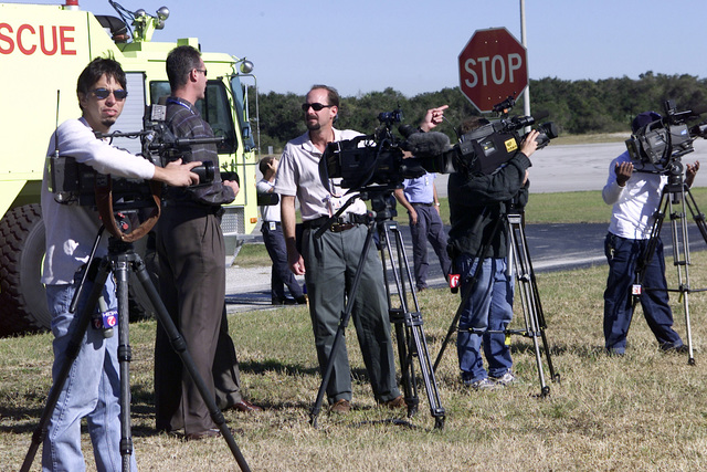 Members of several Central Florida news agencies, photographers and videographers alike, wait at Cape Canaveral Air Station, Florida, for the arrival of the 125th Fighter Wing (FW), Public Affairs Officer, at Jacksonville International Airport (IAP)