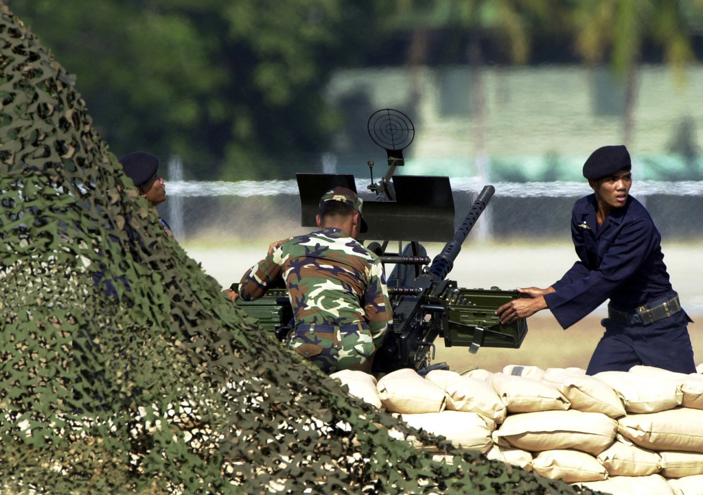 Royal Thai Air Force personnel demonstrate anti-aircraft gun