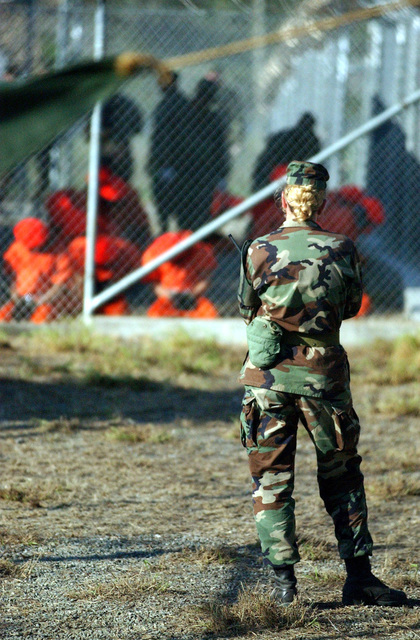 US Army (USA) Military Police (MP) Private First Class (PFC) Jodi Smith, stands perimeter watch while new detainees in-process at Camp X-Ray, Guantanamo Bay Navy Base, Cuba. Camp X-Ray is the holding facility for detainees held at the US Navy (USN) Base during Operation ENDURING FREEDOM