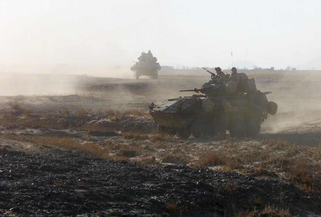 Kicking up a bit of a dust cloud, two Marine LAV-25s (Light Armored Vehicle-25) with Alpha Company, Second Light Armored Reconnaissance Battalion, 26th Marine Expeditionary Unit (Special Operations Capable) conduct a mounted patrol. The M242 25mm chain gun mounted in the turret clearly visable. Also with its 7.62 mm Machine gun manned by a Marine. The LAVs are near the Kandahar International Airport, Kandahar, Afghanistan, during OPERATION ENDURING FREEDOM