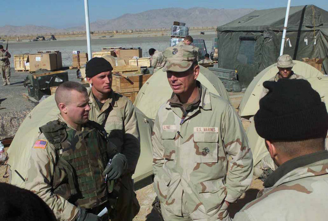 Lieutenant Colonel Jerome Lynes (center), USMC, Commanding Officer Battalion Landing Team 3/6, 26th Marine Expeditionary Unit (Special Operations Capable) discusses transfer of command issues with Marines and Army soldiers in his bivouac site at Kandahar International Airport, Kandahar, Afghanistan, during OPERATION ENDURING FREEDOM. The purpose of the discussion is to facilitate a smooth exchange of command from the Marines to the Army