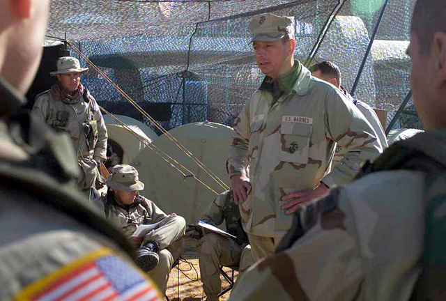 Lieutenant Colonel Jerome Lynes, USMC, Commanding Officer Battalion Landing Team 3/6, 26th Marine Expeditionary Unit (Special Operations Capable) addresses an audience of Marines and Army soldiers in his bivouac site at Kandahar International Airport, Kandahar, Afghanistan, during OPERATION ENDURING FREEDOM
