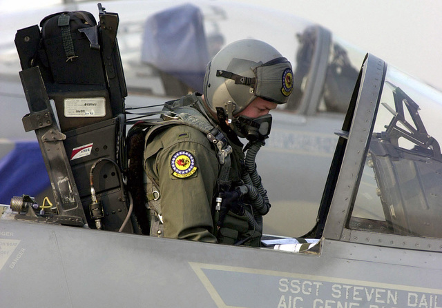 US Air Force (USAF) First Lieutenant (1LT) Luke Brown, F-15C Eagle aircraft pilot assigned to the 19th Fighter Squadron (FS), runs through the preflight check list as he sits in the cockpit of his aircraft on the flight line at Korat AB, Thailand, during Exercise COPE TIGER '02. Cope Tiger is an annual, multinational exercise in the Asia-Pacific region which promotes closer relations and enables air force units in the region to sharpen air combat skills and practice interoperability with US Forces