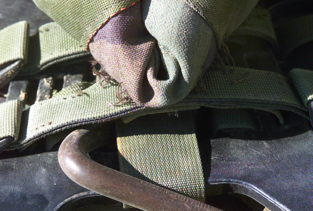 A view of damage to MOLLE (MOdular Lightweight Load-carrying Equipment) pack used by a Marine with Kilo Company, Battalion Landing Team 3/6, 26th Marine Expeditionary Unit (Special Operations Capable) (MEU(SOC)) at the Kandahar International Airport, Kandahar, Afghanistan, during OPERATION ENDURING FREEDOM