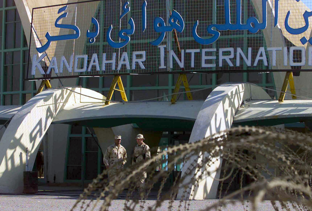 Major Rodney Edwards, USMC, and Lieutenant Colonel Covington, USMC, both with the Marine Central Command Combat Assessment Team, stand in front of the passenger terminal at Kandahar International Airport, Kandahar, Afghanistan, during OPERATION ENDURING FREEDOM