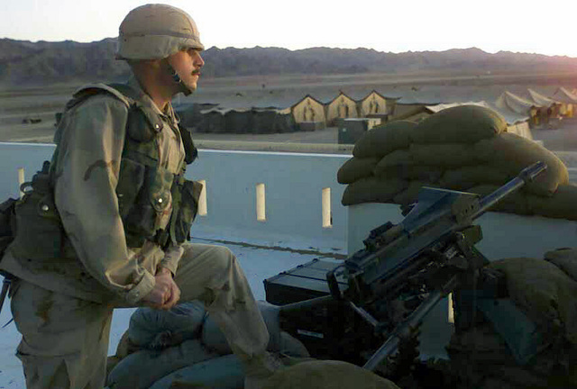 Corporal Jonathan Long, USMC, Kilo Battery, Third Battalion, Tenth Marine Regiment, Battalion Landing Team 3/6, 26th Marine Expeditionary Unit (Special Operations Capable) (MEU(SOC)), provides security with an MK19-3 Grenade Machine Gun for a forward operating base in the Operation ENDURING FREEDOM area of operations