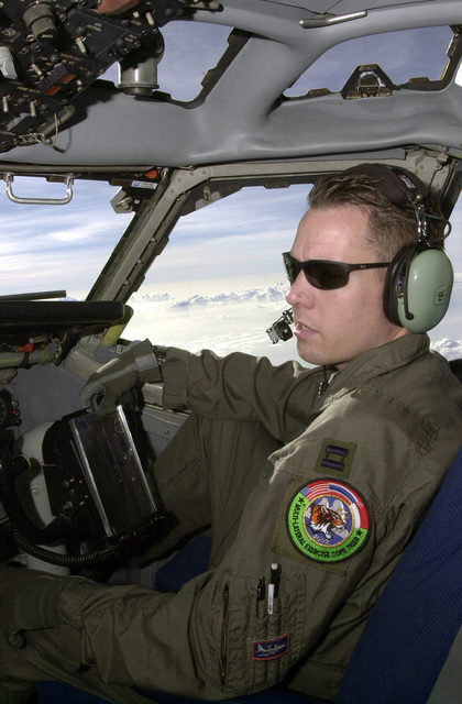 US Air Force (USAF) Captain (CPT) Josh M. Weiland, 961st Airborne Air Control Squadron (AACS), mans the co-pilots position aboard a USAF E-3B Airborne Warning and Control Systems (AWACS) aircraft, while flying a mission during Exercise COPE TIGER '02. Cope Tiger is an annual, multinational exercise in the Asia-Pacific region which promotes closer relations and enables air force units in the region to sharpen air combat skills and practice interoperability with US Forces