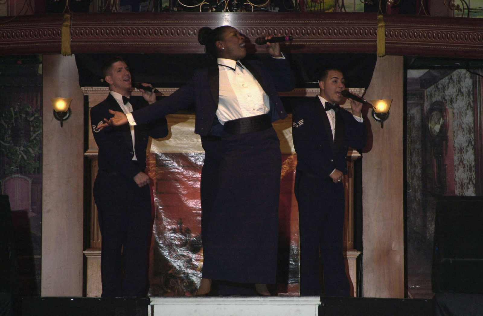 Members of the US Air Force (USAF) premier entertainment showcase, Tops in Blue, perform on stage during their Magic of Music, Broadway Production at Incirlik Air Base (AB), Turkey. Pictured left-to-right, STAFF Sergeant (SSGT) James Bowman, SENIOR AIRMAN (SRA) Kristina D. Robinson, and SRA Richard Vasquez, Jr