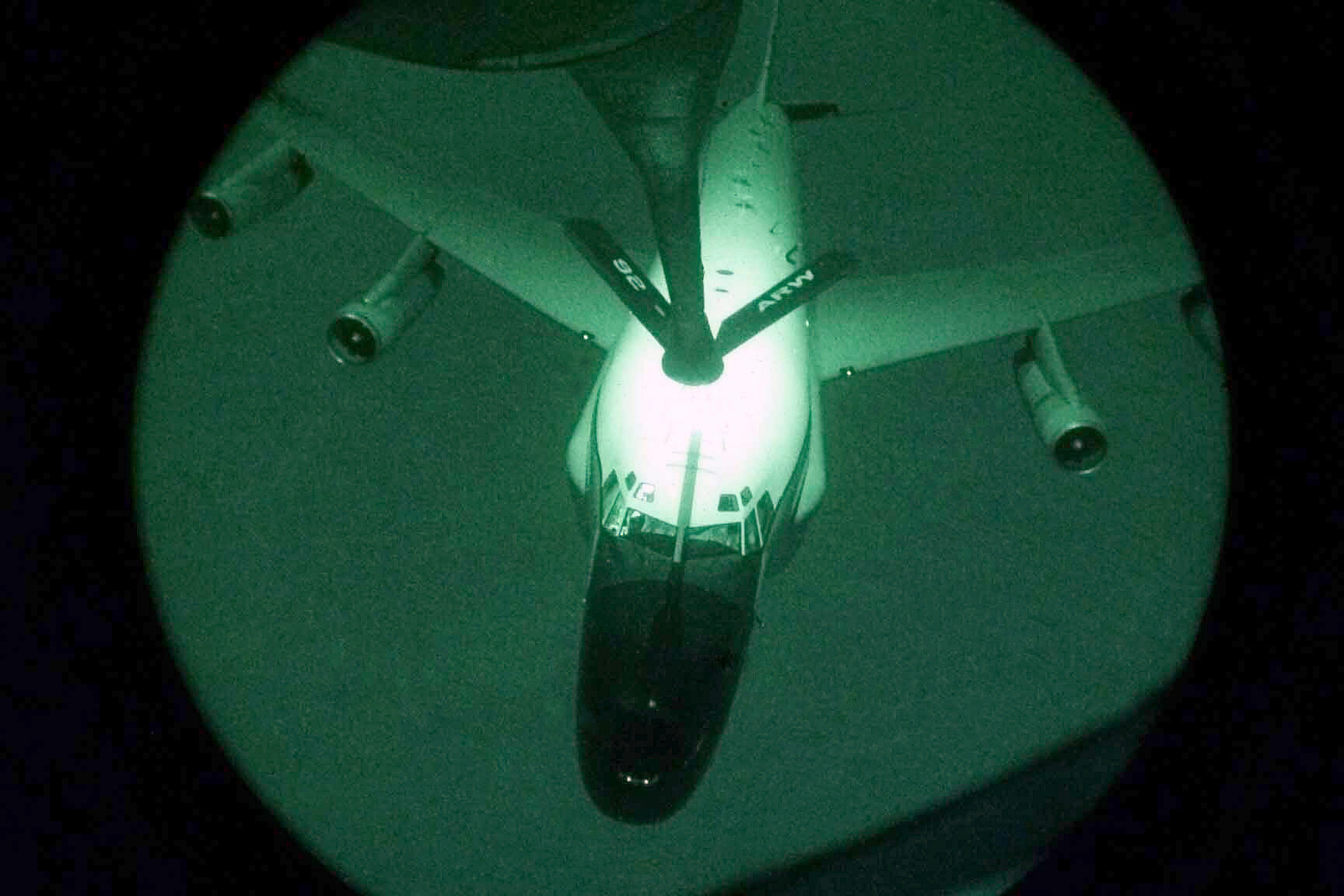 Light enhanced, fisheye lens view, showing a USAF RC-135 Rivet Joint aircraft, approaching the refueling boom of a USAF KC-135 Stratotanker aircraft, from the 96th Air Refueling Squadron, while patrolling the no fly zone over Southern Iraq, in support of Operation SOUTHERN WATCH