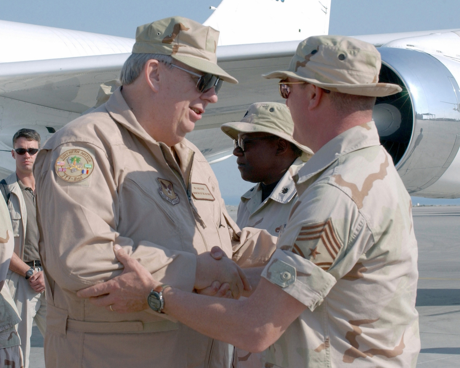 Secretary of the Air Force, The Honorable James G. Roche (left), is greeted by US Air Force (USAF) Command CHIEF MASTER Sergeant (CCMST) Patrick Melton, 319th Air Refueling Wing (ARW), upon his arrival at the forward operations base for the 319TH ARW, during Operation ENDURING FREEDOM