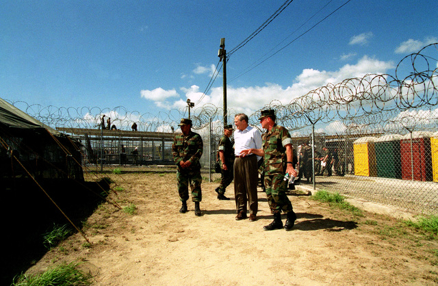 The Honorable Donald H. Rumsfeld (center), U.S. Secretary of Defense (SECDEF), tour of the condition of the 158 Taliban and Al-Qaeda detainees at Camp X-Ray, Guantanamo Bay, Cuba, Jan. 27, 2002.  The SECDEF is in the area to check on the detainees and to visit the troops. (DoD photo by Helene C. Stikkel) (Released)