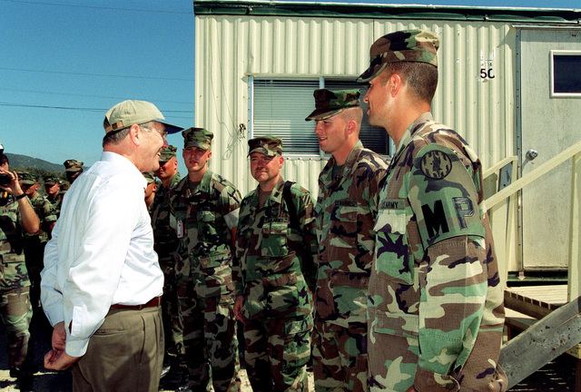 The Honorable Donald H. Rumsfeld (left), U.S. Secretary of Defense (SECDEF), speaks with U.S. Army and U.S. Marine Military Police during his tour of the condition of the 158 Taliban and Al-Qaeda detainees at Camp X-Ray, Guantanamo Bay, Cuba, Jan. 27, 2002.  The SECDEF is in the area to check on the detainees and to visit the troops. (DoD photo by Helene C. Stikkel) (Released)