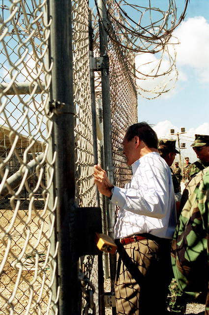 The Honorable Donald H. Rumsfeld, U.S. Secretary of Defense (SECDEF), checks on the condition of the 158 Taliban and Al-Qaeda detainees at Camp X-Ray, Guantanamo Bay, Cuba, Jan. 27, 2002.  The SECDEF is in the area to check on the detainees and to visit the troops. (DoD photo by Helene C. Stikkel) (Released)