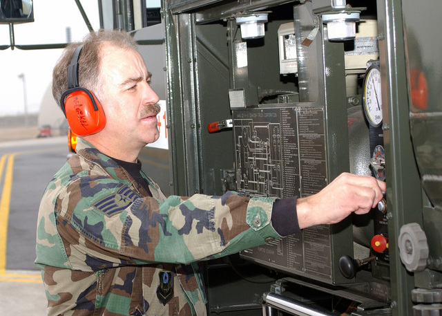 US Air Force (USAF) STAFF Sergeant (SSGT) John McCorkel, 193rd Special Operations Wing (SOW), Pennsylvania Air National Guard (ANG), checks the pressure control dials on a fuel truck during his deployment with the 31st Fighter Wing (FW) at Aviano AB, Italy