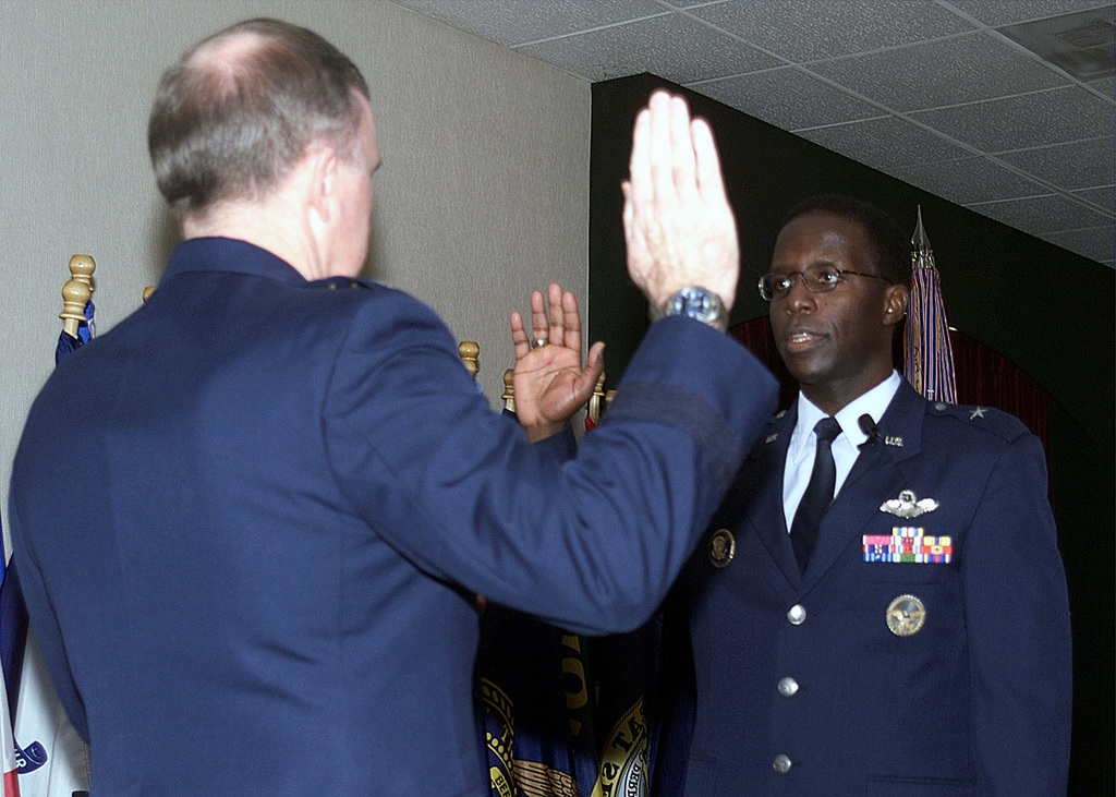 Brigadier General (BGEN) Edward A. Rice, Jr. (right), USAF, Commander, 28th Bomb Wing (BW), Ellsworth AFB, South Dakota, recites the oath of office to Lieutenant General (LGEN) Thomas J. Keck, USAF, Commander, Eighth Air Force, who administered the oath