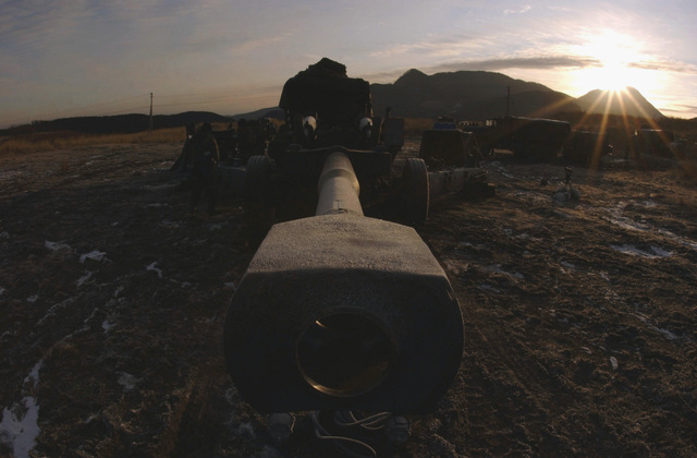 US Marine Corps (USMC) M198 Towed Howitzer gun barrel muzzle from the 3rd Battalion, 12th Marines, Tango Battery, stares out into the east, at the Hijudai Training Grounds, Oita, Japan