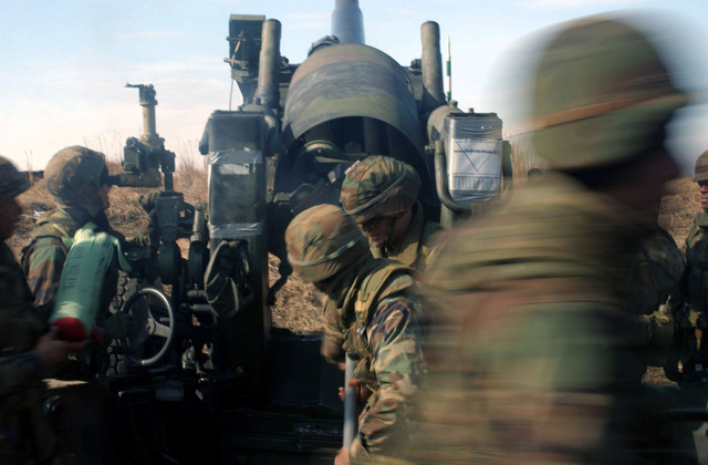 US Marine Corps (USMC) members assigned to the 3rd Battalion, 12th Marines, Tango Battery, move to safety as they fire their M198 Towed Howitzer on the artillery range at the Hijudai Training Grounds, Oita, Japan