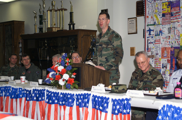 Captain (CAPT) James Taylor, USA, Fort Chaffee Maneuver Training Center, leads a prayer for State and local leaders during the 188th Fighter Wing (FW), Arkansas Air National Guard (AANG), Fort Smith Arkansas, Unit Prayer Breakfast