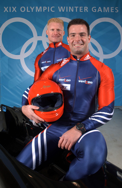 World Class Athletes, SPECIALIST (E-4) Douglas Sharp, USA, rear, and SPECIALIST (E-4) Michael Kohn, USA, posing with a four-man bobsled. SPC Sharp and SPC Kohn will compete at the XIX OLYMPIC WINTER GAMES at the Utah Olympic Park in Park City, Utah, during the 2002 games