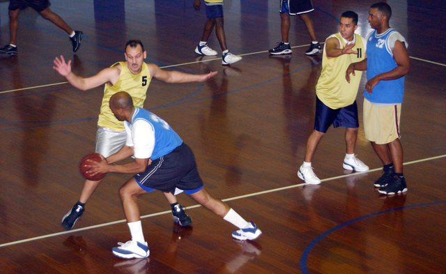 US Air Force (USAF) STAFF Sergeant (SSGT) Durward Till, 31st Communications Squadron, plays defense against USAF Chaplain Keith Darlington, 31st Fighter Wing, during an over 30 basketball game