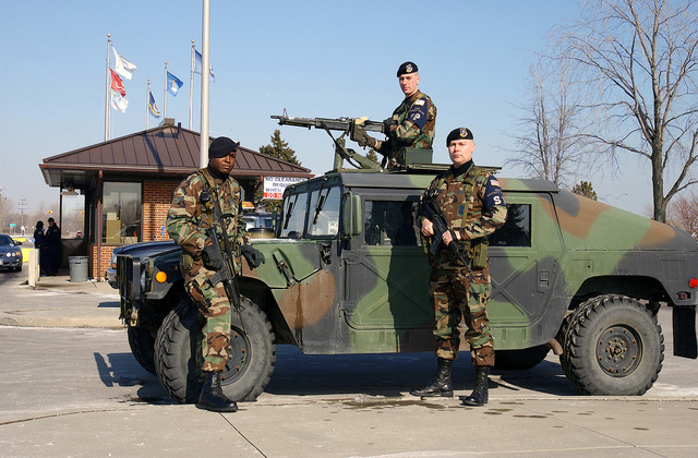 Security personnel from the 127th Security Forces Squadron man an armed M1043 High-Mobility Multipurpose Wheeled Vehicle (HMMWV) as an extra defensive measure to help secure the Main gate of Selfridge Air National Guard Base (ANGB) since the start of Operation NOBLE EAGLE. (Names withheld by request) Security personnel are armed with 5.56mm M16A2 rifles and a Saco 7.62 mm M60 general purpose machine gun on the HMMWV