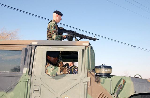 Taking up a defensive position, security personnel, 127th Security Forces Squadron (SFS) man a Saco 7.62 mm M60 general purpose machine gun atop a M1043 High-Mobility Multipurpose Wheeled Vehicle (HMMWV). This is an extra defensive measure to help secure the Main gate of Selfridge Air National Guard Base (ANGB) since the start of Operation NOBLE EAGLE. (Names withheld by request)